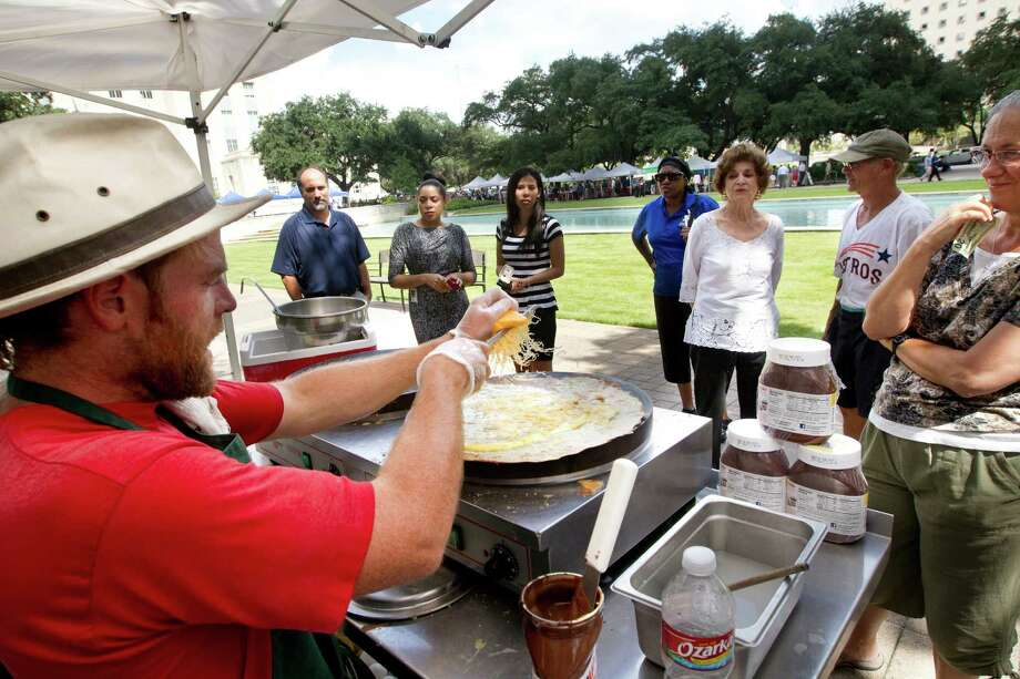 Buffalo Sean prepares crapes for customers at the City Hall Farmer's Market, Wednesday, Sept. 18, 2013, in Houston. The market is open every Wednesday until December 18. Photo: Cody Duty, Houston Chronicle / © 2013 Houston Chronicle