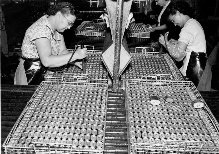 Photo courtesy of Schenectady Museum Archives -- 11-11-55 --This is how G-E Pyranol capacitors are made at Fort Edward Plant. The finished units are widely used in fluorescent ballasts and air conditioners. Photo: SCHENECTADY / ALBANY TIMES UNION