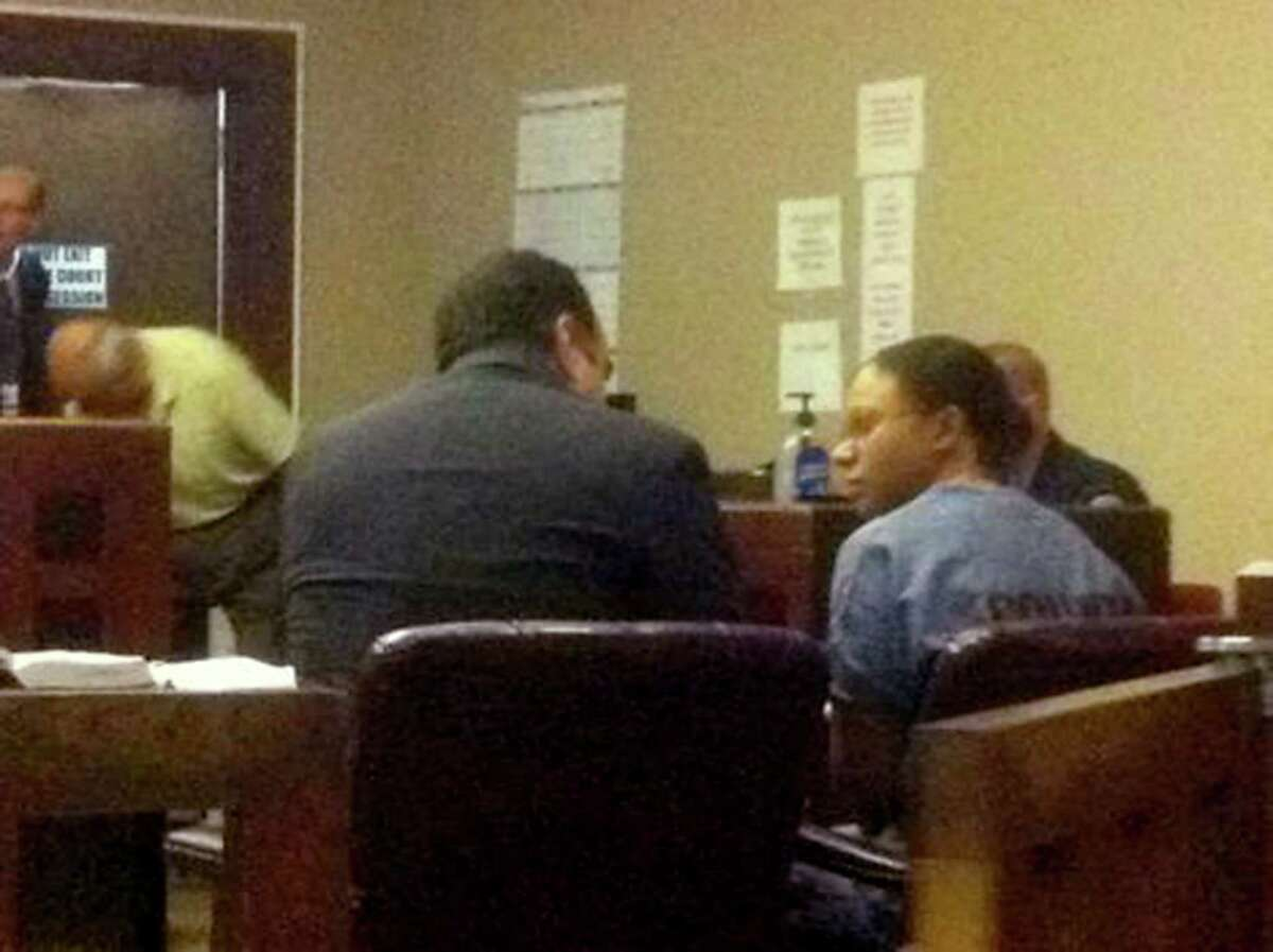 Murder convict Vanessa Cameron, 31, consults with attorney Joseph Esparza Monday, April 23, 2012, prior to a sentencing hearing in which state District Judge Ron Rangel sentenced her to 70 years in prison.