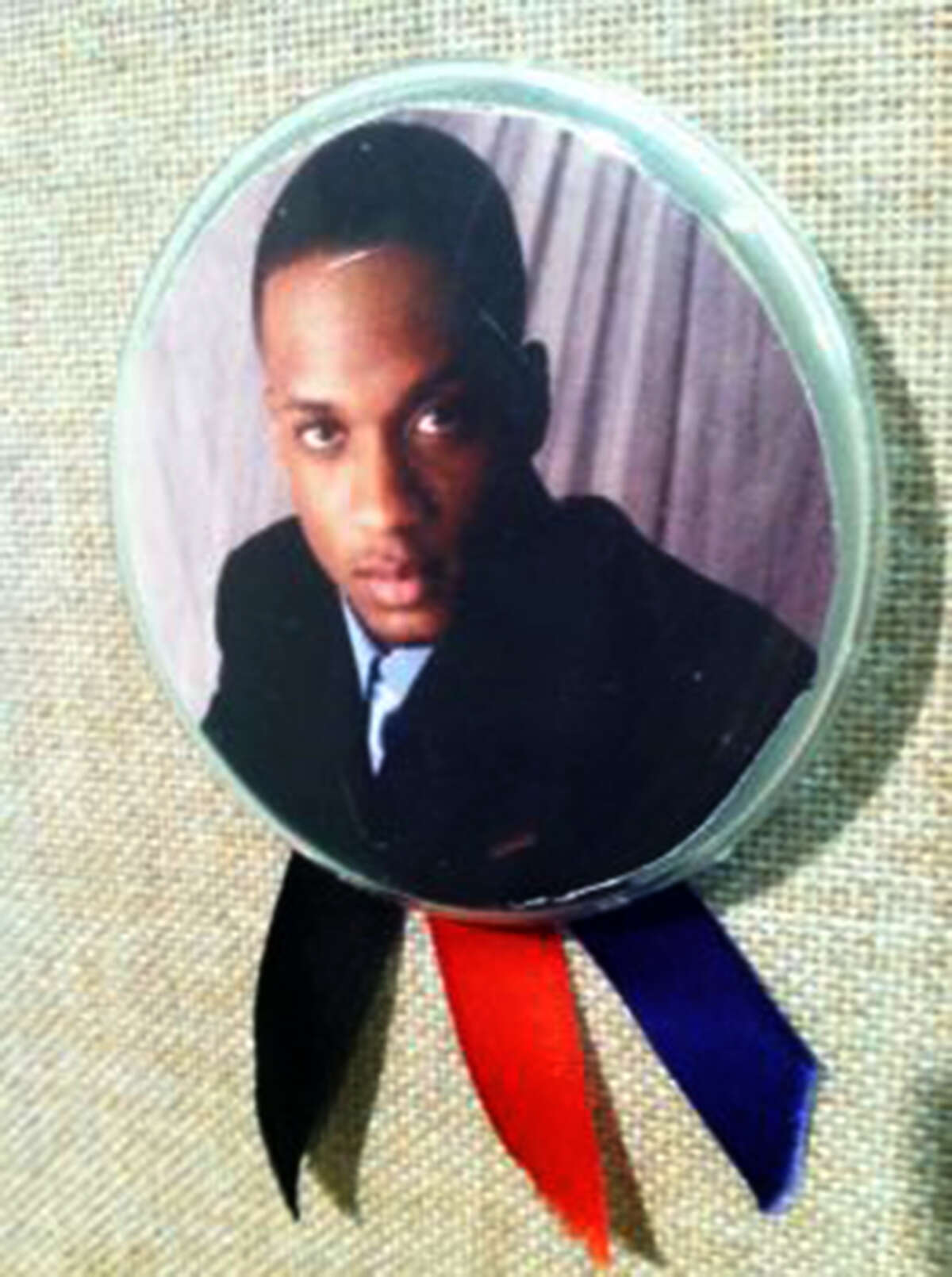 Family and friends of murder victim Samuel Johnson Jr. wore pins depicting his image in court on Monday, April 23, 2012, as ex-girlfriend Vanessa Cameron was sentenced to 70 years in prison for his murder.