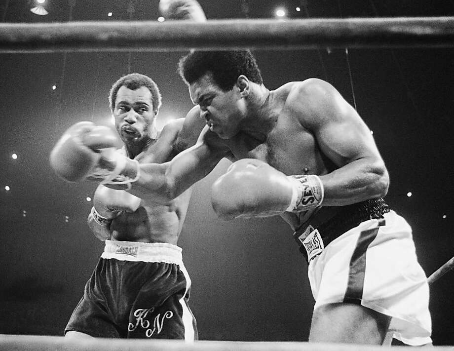 Ken Norton, above left and at left, bothers Muhammad Ali in their second fight, having won the first. Ali won the second by split decision and also narrowly won the third. Photo: Anonymous, Associated Press