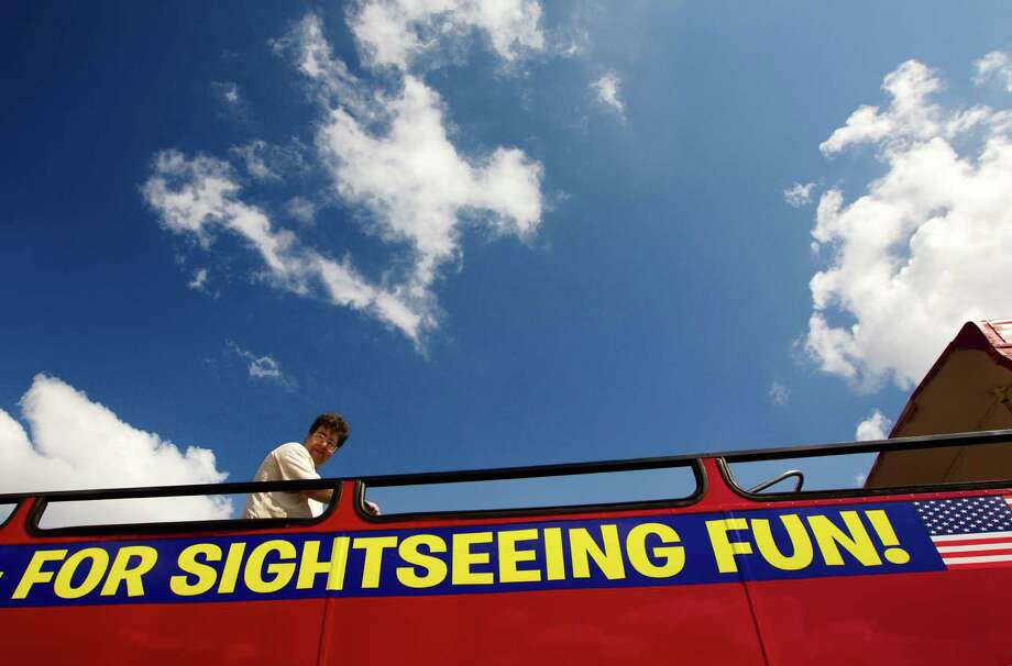 Michael Wolford enjoys the view on a new red double decker tour bus on Thursday, Sept. 12, 2013, in Houston. Photo: J. Patric Schneider, For The Chronicle / © 2013 Houston Chronicle