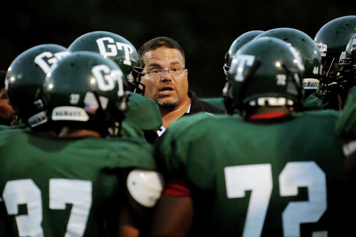Green Tech coach Pete Porcelli, center, has a pep talk with his team during their football game against Mohonasen on Friday, Sept. 2, 2011, at Union College in Schenectady, N.Y. (Cindy Schultz / Times Union)