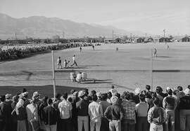 Japanese-American internees watch and play baseball in 1943 at the Manzanar War Relocation Center, located in eastern California north of Lone Pine. For the Japanese-Americans forced to live at the World War II internment camp, baseball was one of the few ways to fight boredom and was a major source of pride. Despite the work to restore the site, which is expected to open to the public in April 2004, the baseball diamond was excluded from the rebuilding plan.