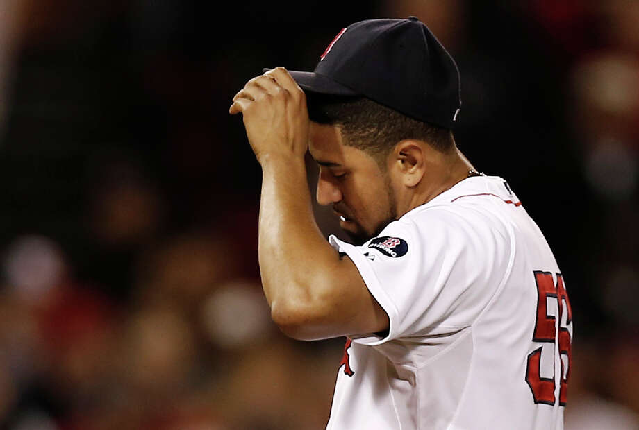 BOSTON, MA - SEPTEMBER 18:  Pitcher Franklin Morales #56 of the Boston Red Sox hangs his head after giving up the winning two-run single to Chris Davis #19 of the Baltimore Orioles during the twelfth inning of their 5-3 loss at Fenway Park on September 18, 2013 in Boston, Massachusetts.  (Photo by Winslow Townson/Getty Images) ORG XMIT: 163495614 Photo: Winslow Townson / 2013 Getty Images
