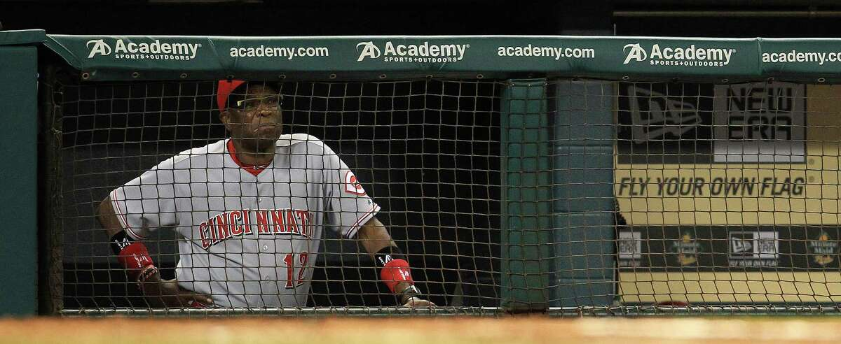 PHOTOS: Astros players' contract situation during offseason Cincinnati Reds manager Dusty Baker (12) watches the game from the dugout during the fourth inning of an MLB game at Minute Maid Park, Wednesday, Sept. 18, 2013, in Houston. >>>Browse through the photos for a look at the contract situation for each Houston Astros player during this offseason ...