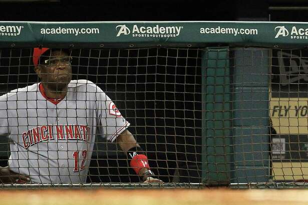 Cincinnati Reds manager Dusty Baker (12) watches the game from the dugout during the fourth inning of an MLB game at Minute Maid Park, Wednesday, Sept. 18, 2013, in Houston.