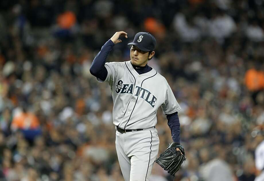 Seattle Mariners starting pitcher Hisashi Iwakuma reacts to an out against the Detroit Tigers in the sixth inning of a baseball game in Detroit, Wednesday, Sept. 18, 2013. (AP Photo/Paul Sancya) Photo: Paul Sancya, Associated Press