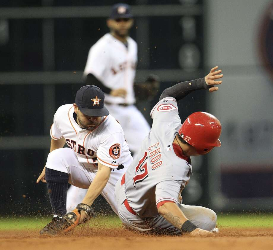 Sept. 18: Reds 6, Astros 5 (13)  Astros second baseman Jose Altuve (27) tags out Reds center fielder Shin-Soo Choo. Photo: Karen Warren, Houston Chronicle