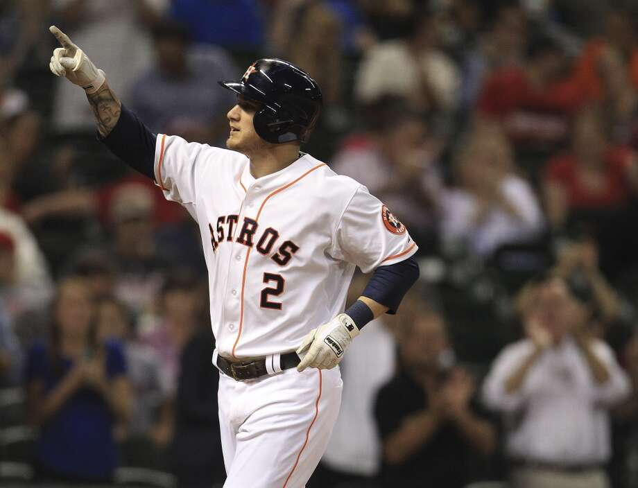 Astros center fielder Brandon Barnes (2) celebrates his solo home run. Photo: Karen Warren, Houston Chronicle
