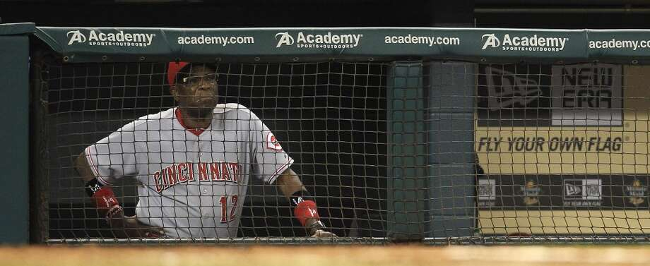 Reds manager Dusty Baker (12) watches the game from the dugout. Photo: Karen Warren, Houston Chronicle