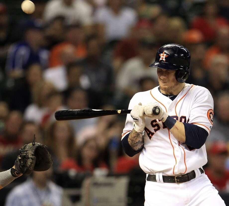 Astros center fielder Brandon Barnes (2) is hit by a pitch. Photo: Karen Warren, Houston Chronicle