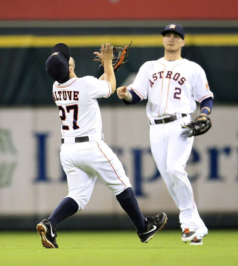 Astros second baseman Jose Altuve (27) reaches out to catch a pop out hit by Reds left fielder Ryan Ludwick. Photo: Karen Warren, Houston Chronicle