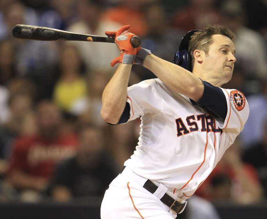 Astros right fielder Trevor Crowe (8) loses his helmet as he strikes out. Photo: Karen Warren, Houston Chronicle