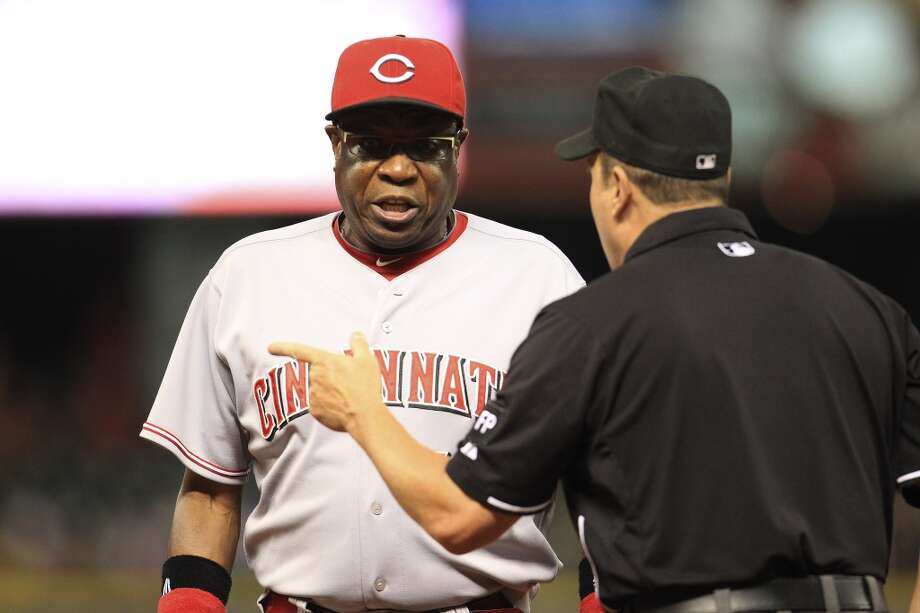 Reds manager Dusty Baker (12) argues a call with umpire Marty Foster on a play where Reds center fielder Shin-Soo Choo (17) grounded out. Photo: Karen Warren, Houston Chronicle
