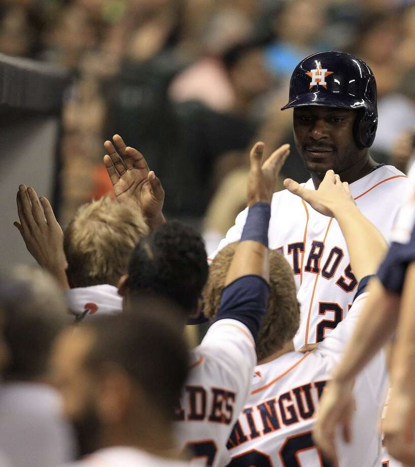 Astros first baseman Chris Carter (23) celebrates his run. Photo: Karen Warren, Houston Chronicle
