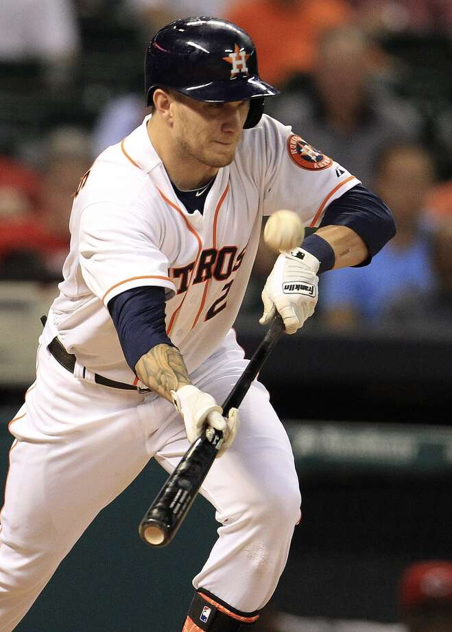 Astros center fielder Brandon Barnes (2) tries to hit a sac bunt. Photo: Karen Warren, Houston Chronicle