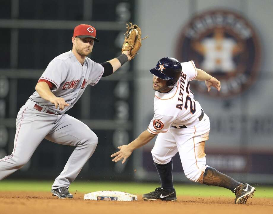 Reds shortstop Zack Cozart (2) tags out Astros second baseman Jose Altuve (27) as he was caught stealing. Photo: Karen Warren, Houston Chronicle