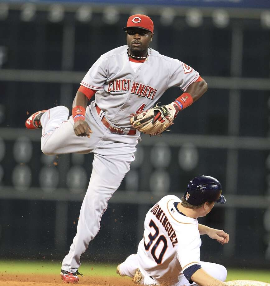 Reds second baseman Brandon Phillips (4) jumps up after getting Astros third baseman Matt Dominguez (30) out. Photo: Karen Warren, Houston Chronicle
