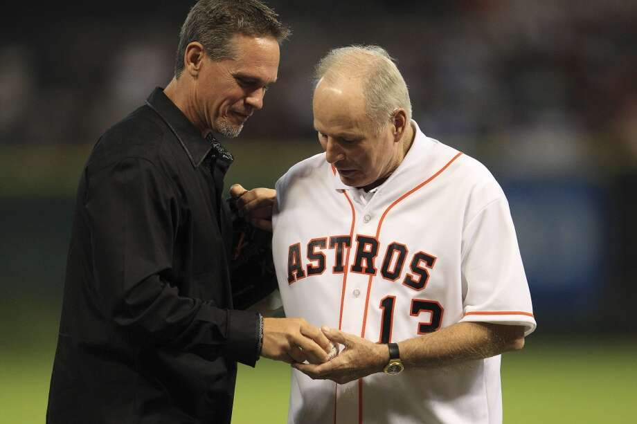 Don Sanders gets a hug from Craig Biggio who caught his first pitch. Photo: Karen Warren, Houston Chronicle