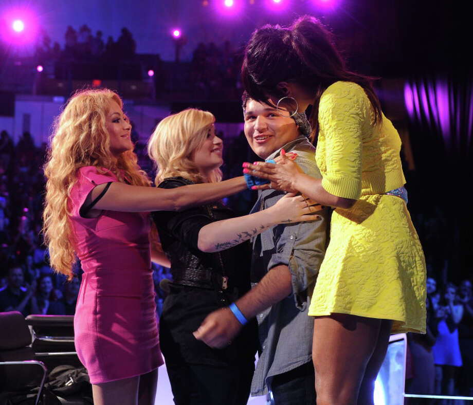 THE X FACTOR: Contestant Carlos Guevara (Center) with Judges (L-R) Paulina Rubio, Demi Lovato and Kelly Rowland on THE X FACTOR airing Wednesday, Sep. 18 (8:00-10:00 PM ET/PT) on FOX. CR: Ray Mickshaw/ FOX. © Copyright 2013 / FOX.