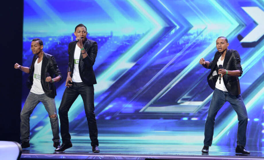 THE X FACTOR: AKNU pefrorms in front of the Judges on THE X FACTOR airing Wednesday, Sep. 18 (8:00-10:00 PM ET/PT) on FOX. CR: Ray Mickshaw/ FOX. © Copyright 2013 / FOX.