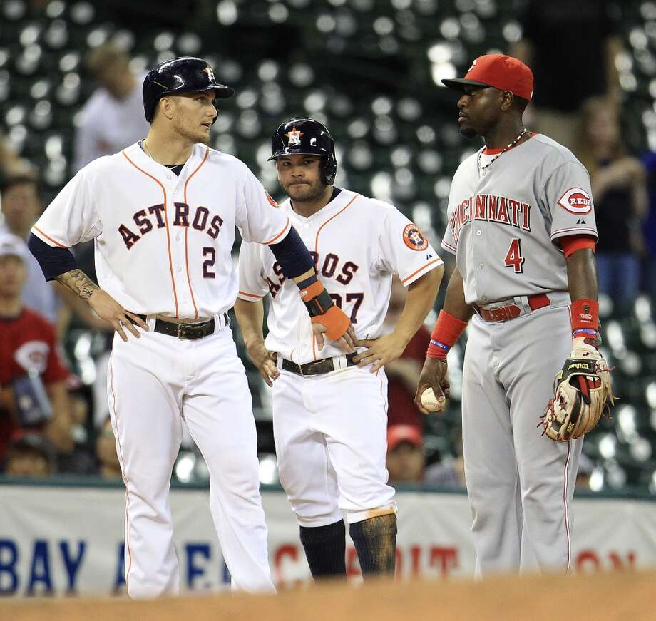 Houston Astros second baseman Jose Altuve (27) stands behind Brandon Barnes (2) as they both stand on third base, as Cincinnati Reds second baseman Brandon Phillips (4) tags out Altuve during the eleventh  inning of an MLB game at Minute Maid Park, Wednesday, Sept. 18, 2013, in Houston.  ( Karen Warren / Houston Chronicle ) Photo: Houston Chronicle