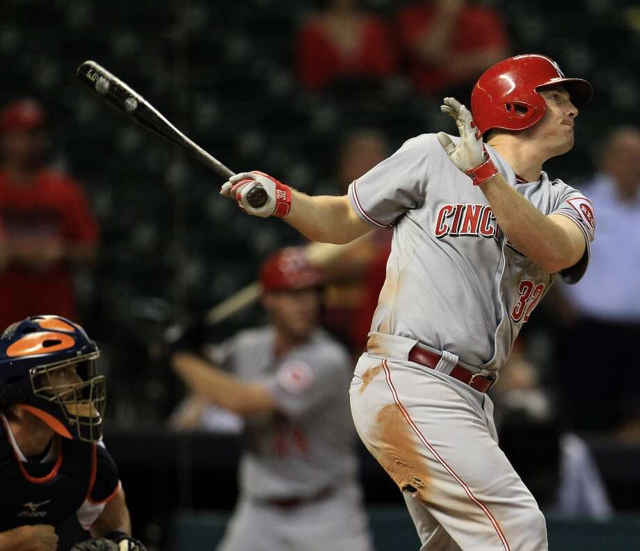 Cincinnati Reds right fielder Jay Bruce (32) hits his game winning RBI double during the thirteenth inning of an MLB game at Minute Maid Park, Thursday, Sept. 19, 2013, in Houston.  ( Karen Warren / Houston Chronicle ) Photo: Houston Chronicle