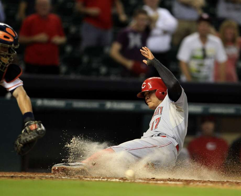 Cincinnati Reds center fielder Shin-Soo Choo (17) scores on Jay Bruce's game winning RBI double during the thirteenth inning of an MLB game at Minute Maid Park, Thursday, Sept. 19, 2013, in Houston.  ( Karen Warren / Houston Chronicle ) Photo: Houston Chronicle