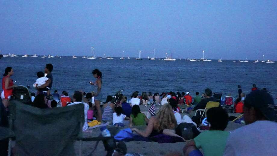 A July 4 crowd at Jennings Beach twice the size of the year before has prompted the Parks and Recreation Commission to consider raising the day parking fee as a way to limit the turnout. Photo: Genevieve Reilly / Fairfield Citizen