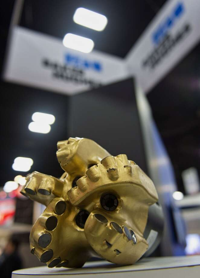 A Baker Hughes Inc. drilling bit is displayed at the Hart Energy DUG Eagle Ford Shale conference in San Antonio, Texas, U.S., on Wednesday, Sept. 18, 2013. The conference focuses on the industry's business challenges and opportunities in identifying and developing unconventional resources. Photo: Eddie Seal, Bloomberg