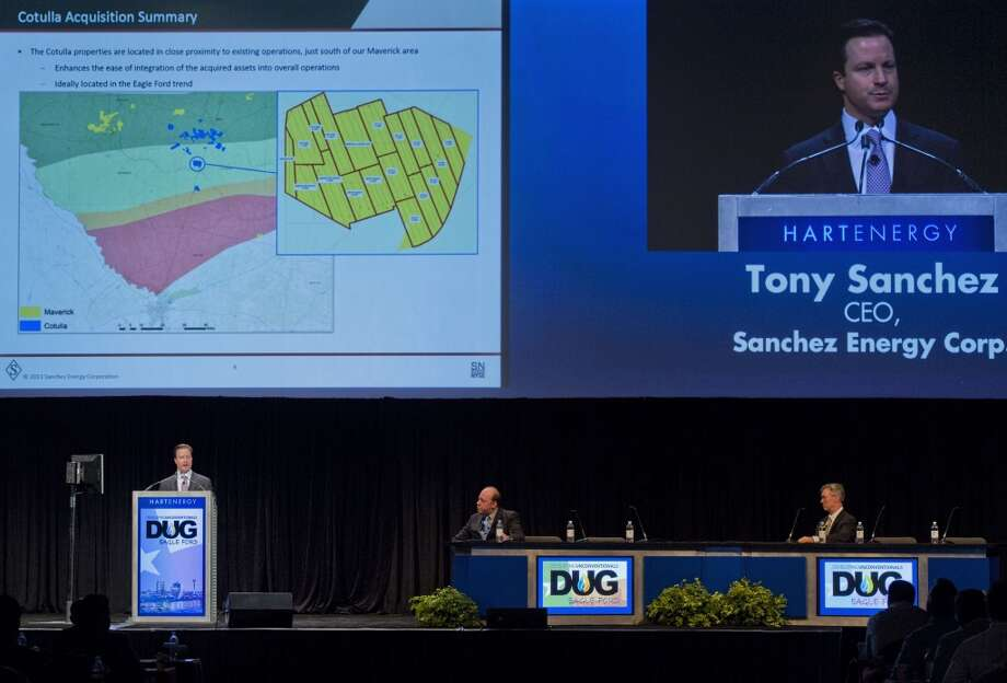 Tony Sanchez, chief executive officer for Sanchez Energy Corp., left, speaks at the Hart Energy DUG Eagle Ford Shale conference in San Antonio, Texas, U.S., on Wednesday, Sept. 18, 2013. The conference focuses on the industry's business challenges and opportunities in identifying and developing unconventional resources. Photo: Eddie Seal, Bloomberg