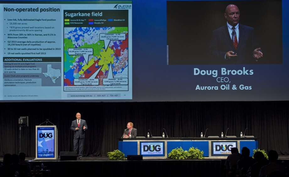 Doug Brooks, chief executive officer for Aurora Oil & Gas Ltd., left, speaks at the Hart Energy DUG Eagle Ford Shale conference in San Antonio, Texas, U.S., on Wednesday, Sept. 18, 2013. The conference focuses on the industry's business challenges and opportunities in identifying and developing unconventional resources. Photo: Eddie Seal, Bloomberg