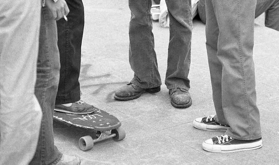 "A close-up of the footwear -- lots of Converse and work boots at Lincoln. Note that ""Locals"" is written on the skateboard. These guys were characterized in the article as the ""White Punks on Dope."" Photo: Gary Fong, The Chronicle"
