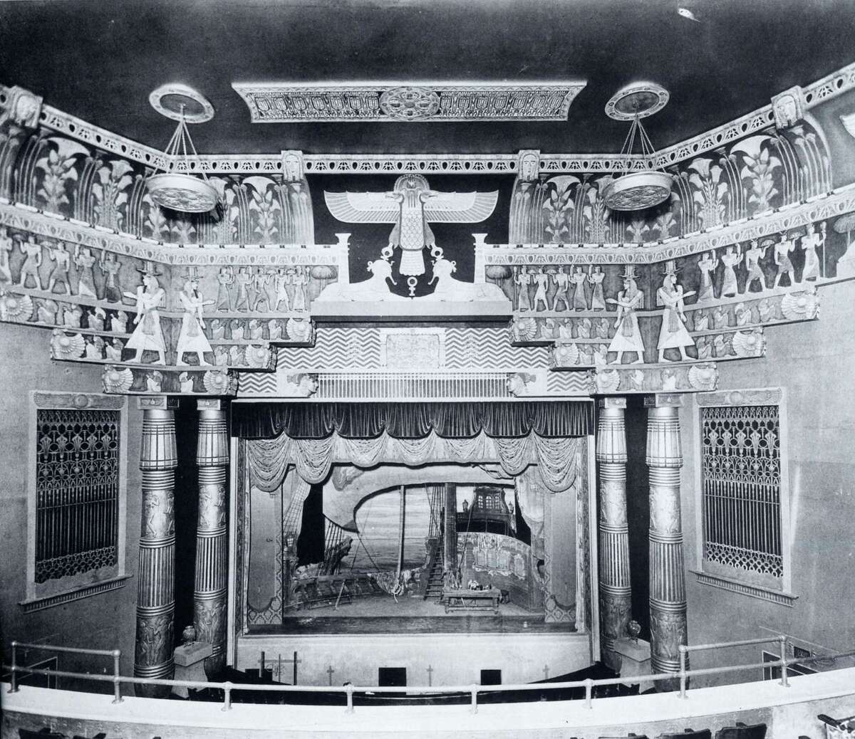 The whacked-out Egyptian-theme interior of the Metropolitan Theatre, circa 1927, when it was at Main and Travis is pictured. It was one of downtown's