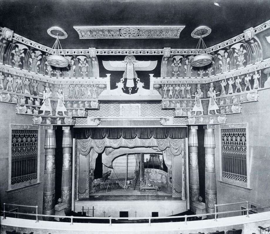 """The whacked-out Egyptian-theme interior of the Metropolitan Theatre, circa 1927. Located at Main and Travis, it was one of downtown's """"Big Three"""" movie palaces. Nekhebet, the Egyptian vulture deity, lords over the stage. It was demolished in 1973. Photo: Houston Metropolitan Research Ce / handout book scan"""