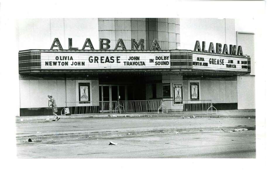 "The Alabama Theater assistant manager sweeps up debris Sunday morning left by late night movie crowd who came to see ""Grease,"" starring John Travolta and Olivia Newton John, in 1978. Photo: Tony Bullard, Houston Chronicle / Houston Post files"