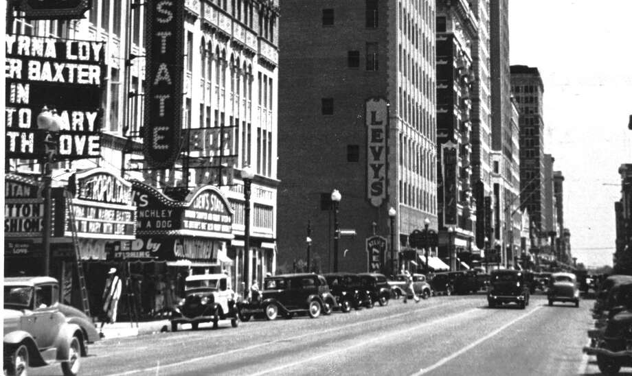 The picture shows Houston's movie theater district along Main Street in 1936 looking north from Lamar. Photo: Houston Chronicle Files / Houston Chronicle