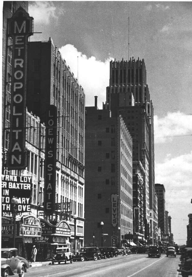 "This picture shows a view of the movie theater district along Main Street looking north from Lamar in 1936. The Metropolitan Theater and Loew's State have ""cool"" and ""air conditioned"" signs hanging from their marquees and Levy's dry goods store, and the Gulf Building and Rice Hotel can be seen in background. Photo: Houston Chronicle Files / Houston Chronicle"