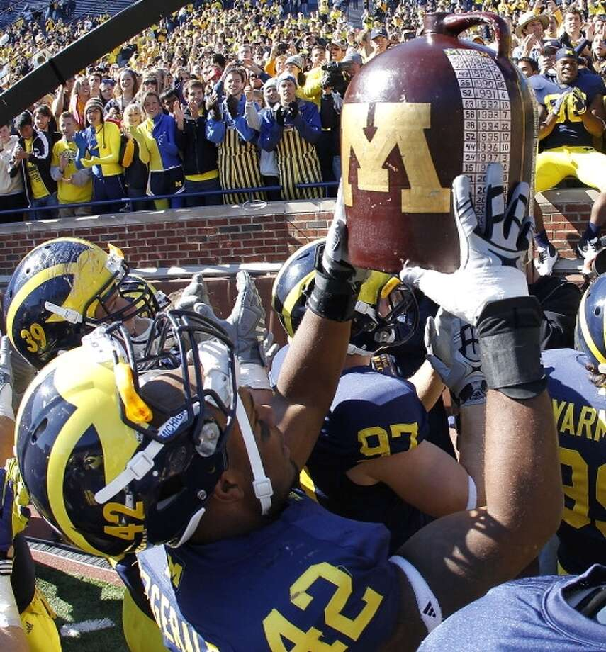 Little Brown Jug Teams: Michigan Wolverines vs. Minnesota Golden Gophers Introduced: 1903 Photo: Leon Halip, Getty Images