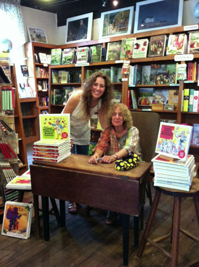 "Author Judi Barrett will greet fans and sign copies of her two new books in the ""Cloudy With a Chance of Meatballs"" series at Bank Street Book Nook in New Milford on Saturday, Sept. 28. She's shown here, seated, at a signing last month at House of Books in Kent. Photo: Contributed Photo"