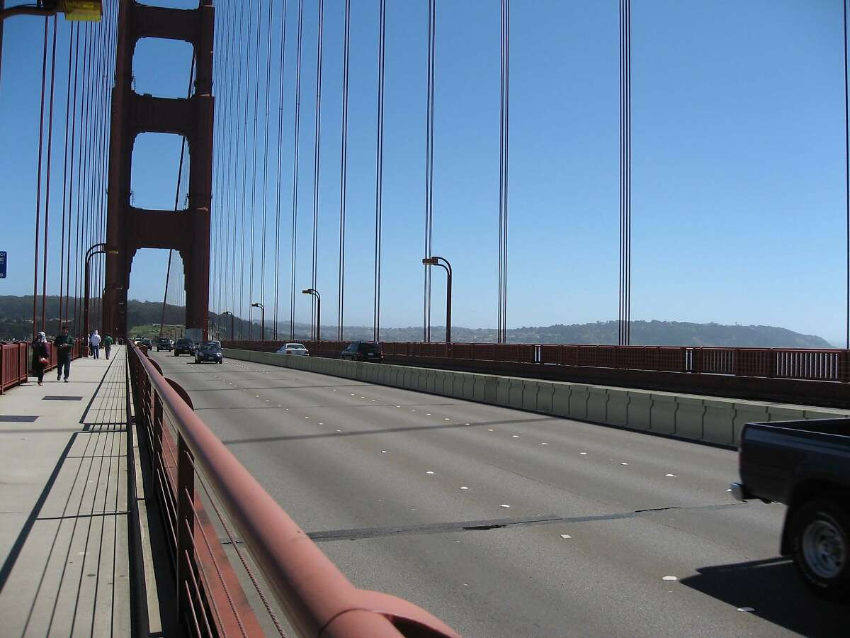 A digitally enhanced photograph shows details of what the Golden Gate Bridge District's proposed moveable lane barrier would look like when installed between the span's northbound and southbound lanes. The safety measure to prevent head-on crashes has been in the works for years and officials now say it will be installed in early 2015.