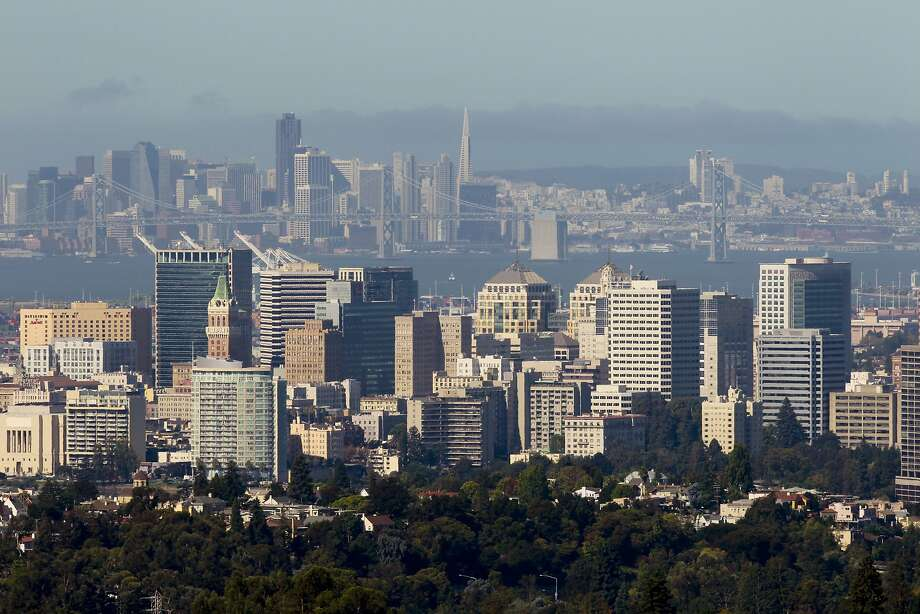 The skyline of Oakland in the shadow of San Francisco, as seen from the Oakland hills.  Photo: Michael Macor, The Chronicle