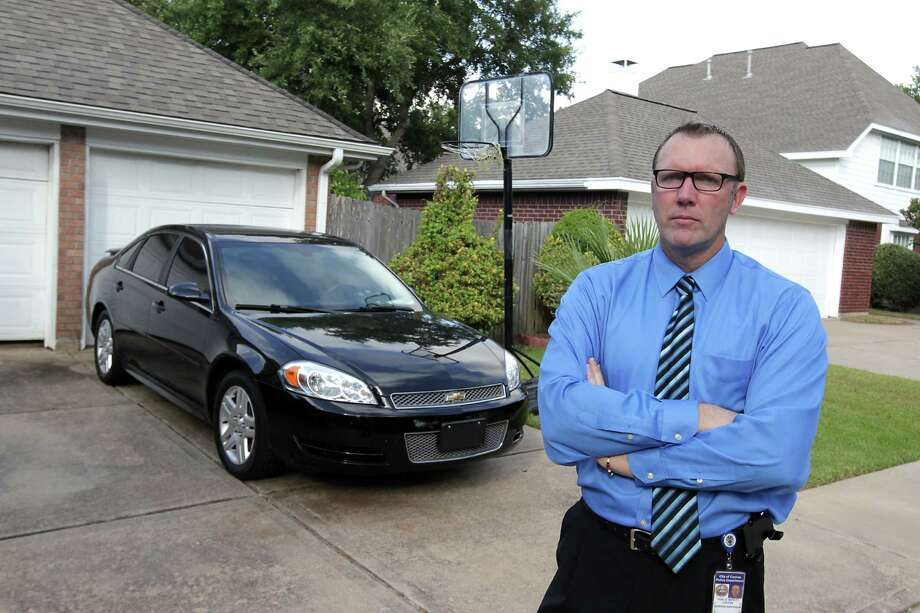 Warren Diepraam, a veteran vehicular crimes prosecutor, started backing into his driveway years ago, after seeing so many children run over trying to say goodbye to a parent. By backing in, he figured that if they chased after him to say goodbye, he would have a better chance of seeing them coming.  Photo: James Nielsen, Houston Chronicle / © 2013  Houston Chronicle