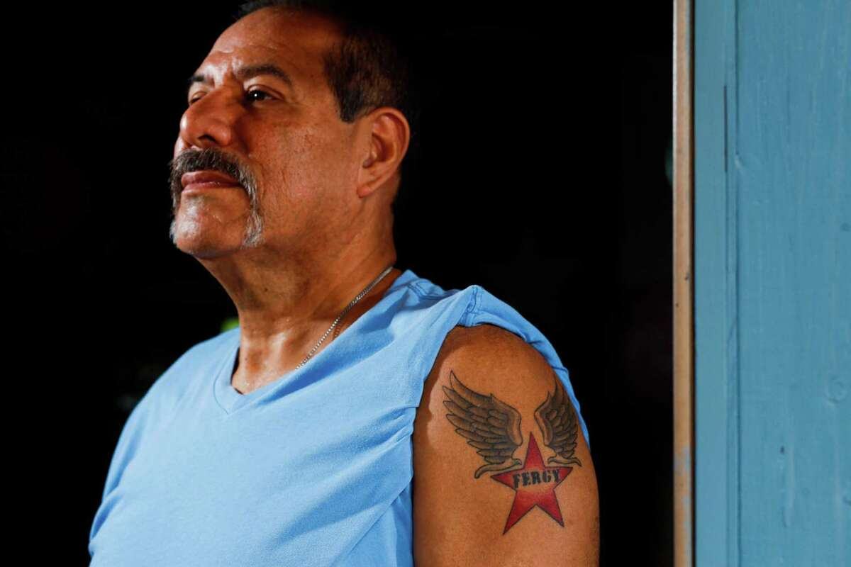 Danny Almendarez, 57, has Fergy's name tattooed on his bicep. He often stops by her grave after Mass.
