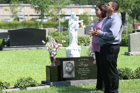 "Nancy and David Rodriguez visit their daughter Fernanda ""Fergy"" Rodriguez's grave. The family often gathers at the cemetery on weekends to have pizza or breakfast tacos with Fergy."