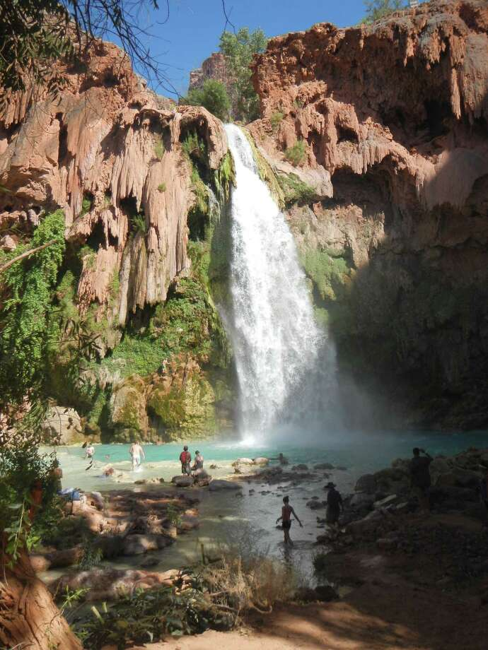 The turquoise water at Havasupai is colored by travertine, which coats the creek bed and offers hikers a wonderful cool-down after a long, dusty walk. Photo: For The Express-News