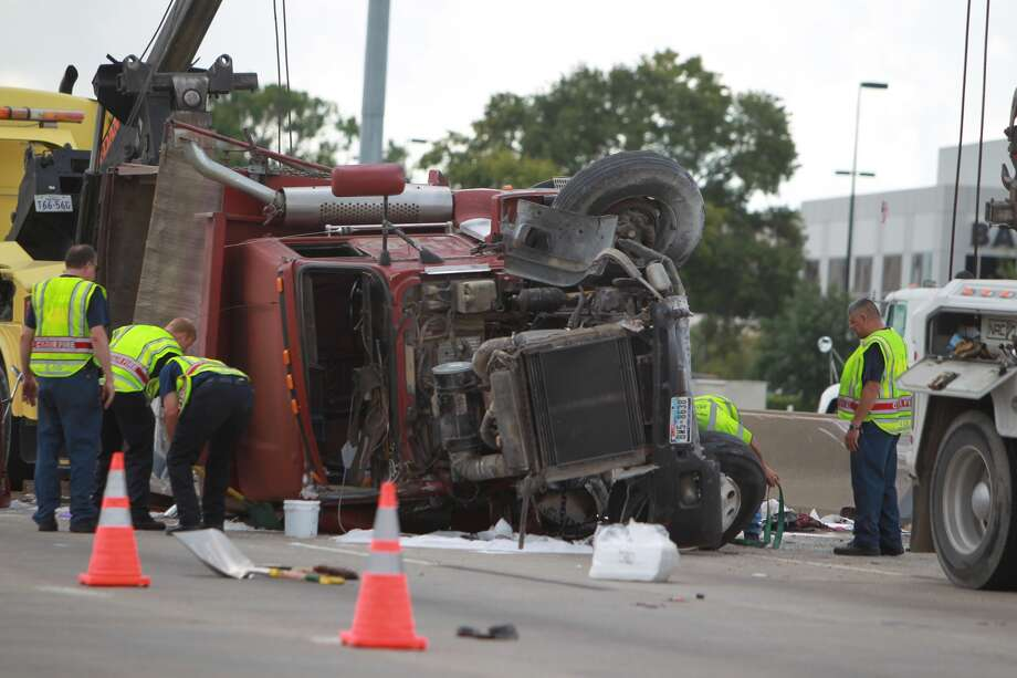 Overturned big rig is blocking three lanes on westbound 290 at Gessner on Thursday, Sept. 19,2013. ( Mayra Beltran / Houston Chronicle ) Photo: Mayra Beltran, Houston Chronicle