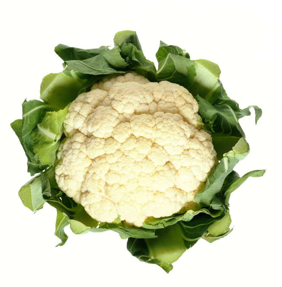 Cauliflower stems and leaves: Instead of always cutting the florets off the stem, cut into the whole head and through the stem to make cauliflower steaks about ½-inch thick. The flat surface caramelizes well when you pan-fry or roast them. Add in the tender leaves at the end of cooking.