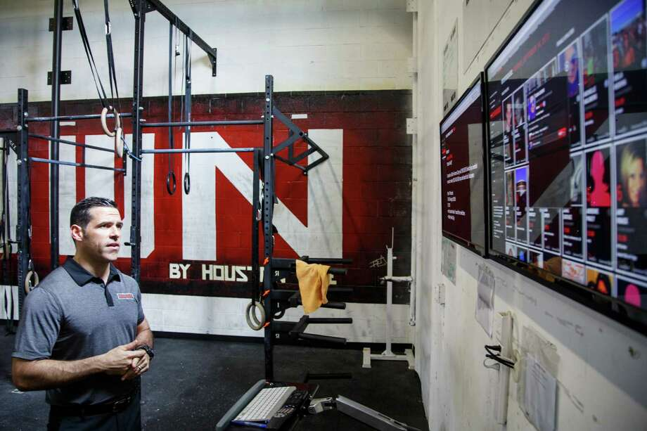 Theo Tsekouras, owner and lead instructor at CrossFit H-Town, uses Wodify to track clients' progress. Photo: Michael Paulsen, Staff / © 2013 Houston Chronicle